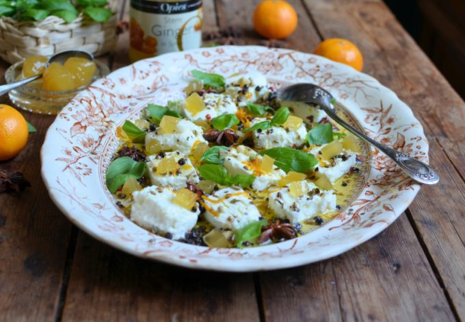 Marinated Goats Cheese with Stem Gingerand Fennel, Star Anise, Orange, Garlic, Basil and mixed Peppercorns on Lemon Olive Oil