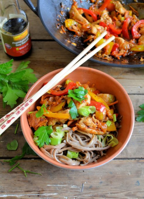 Kung Pao Stir-Fry Chicken and Noodle Bowls - Delicious bowls of noodles with spicy Kung Pao Chicken & Peppers, all made with ease using Lee Kum Kee's ready-made Kung Pao Chicken Stir-Fry sauce, and on the table in under half an hour.